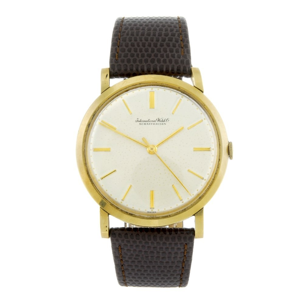 IWC - a gentleman's yellow metal wrist watch.