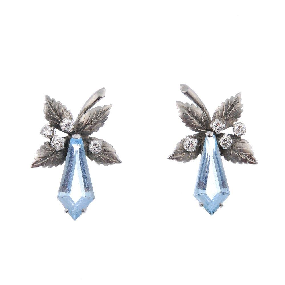 A pair of aquamarine and diamond foliate earrings.