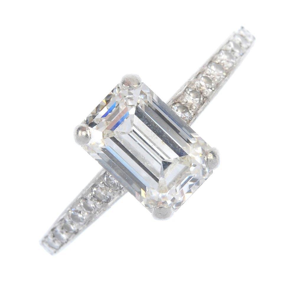 CARTIER - a platinum diamond single-stone ring.