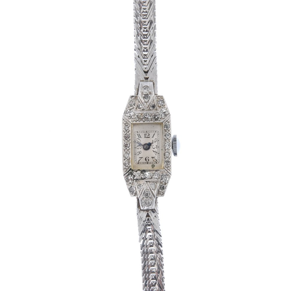 A lady's diamond manual wind cocktail watch.