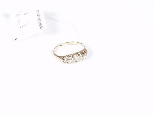 1001: 18ct gold five stone old cut diamond bo