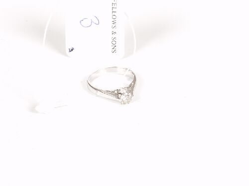 1003: 18ct white gold claw set single stone d