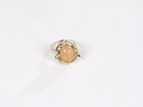1010: Oval opal single stone dress ring in a