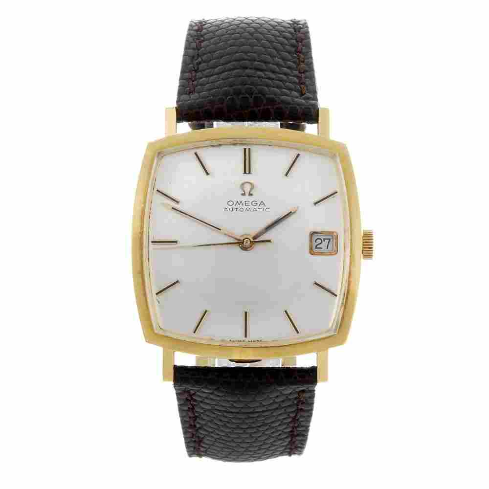 OMEGA - a gentleman's yellow metal wrist watch.