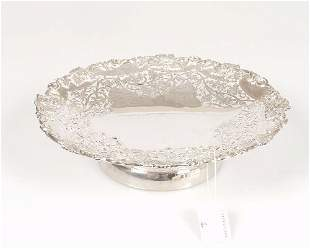 A silver tazza with pierced and applied