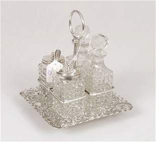A miniature cruet set, fitted with four