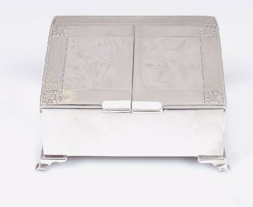 2015: A silver cigarette case with slanting l