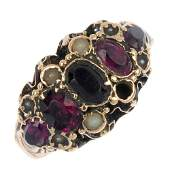 A mid Victorian 9ct gold garnet and split pearl ring