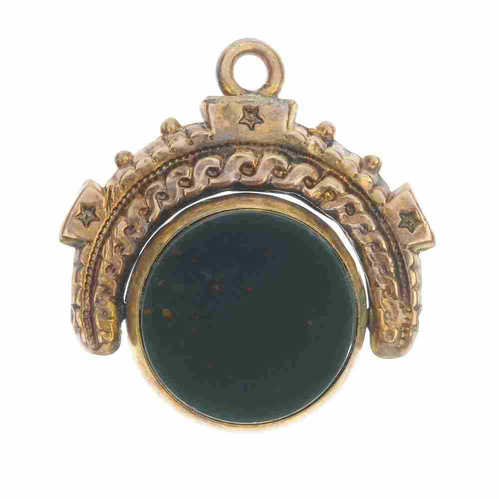 A late 19th century hardstone swivel fob and watch key.
