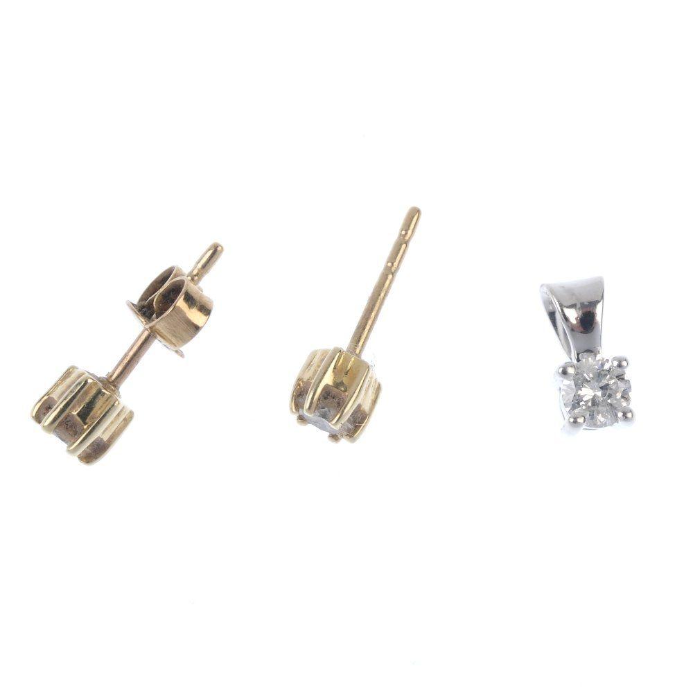 A 9ct gold diamond pendant and diamond ear studs.