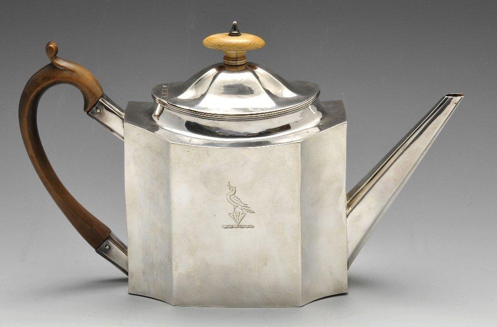 A George III silver teapot.