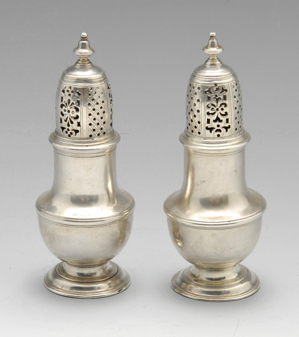 A pair of George II silver casters.