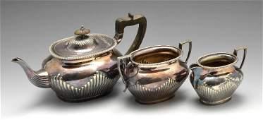 An Edwardian silver plated Elkington & Co. three piece