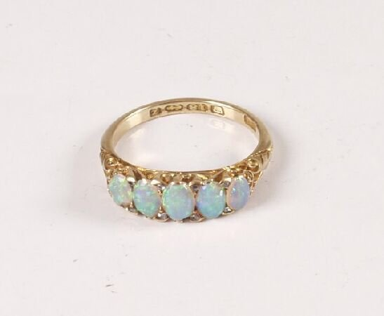 6: 1920's 18ct gold five stone oval opal carved half ho