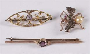 Three brooches to include a 15ct gold amethyst and s
