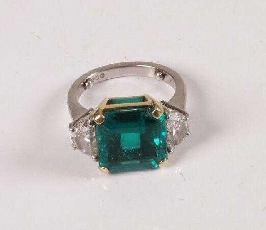 11: Platinum mounted square cut emerald and diamond thr