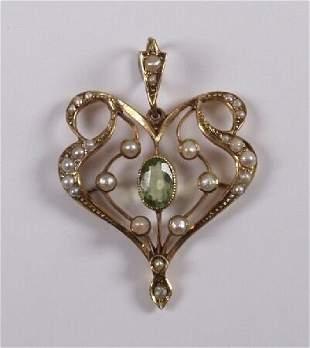 9ct gold Art Nouveau pendant set with a central per