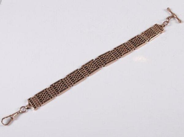 15: 9ct rose gold lattice work design gate style bracel