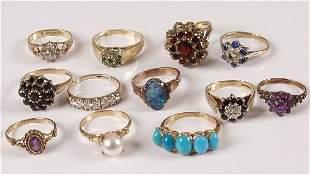 Twelve assorted 9ct gold gem and paste set dress ri