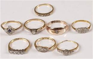 Eight assorted 18ct and 9ct gold diamond set rings.
