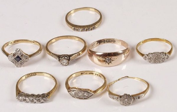 19: Eight assorted 18ct and 9ct gold diamond set rings.