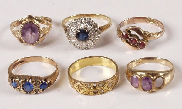 20: 18ct gold sapphire and diamond cluster ring and fiv