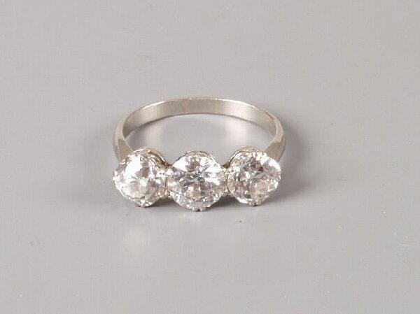 22: An old cut diamond three stone ring of 2.78cts tota