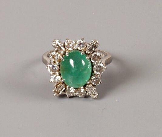 24: 18ct white gold cabochon emerald and diamond dress