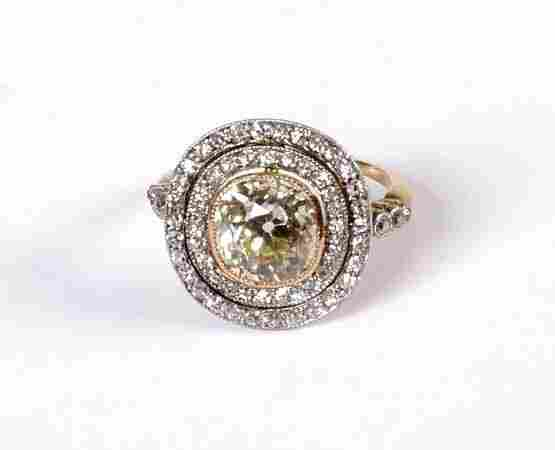 573: Edwardian 18ct gold mounted yellow diamond and dia
