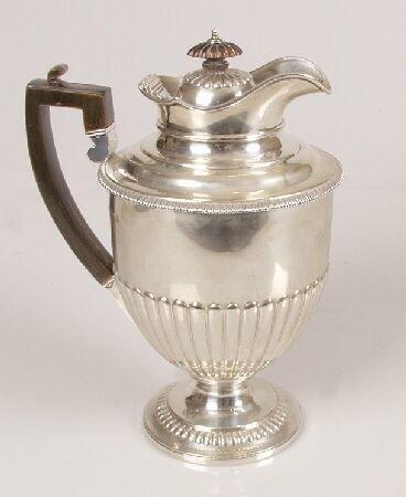 1011: Late Victorian hot water pot, of circular semi-fl