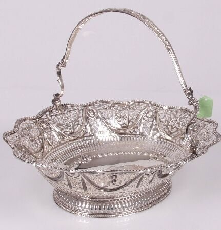 1013: George III swing handled basket, of pierced shape