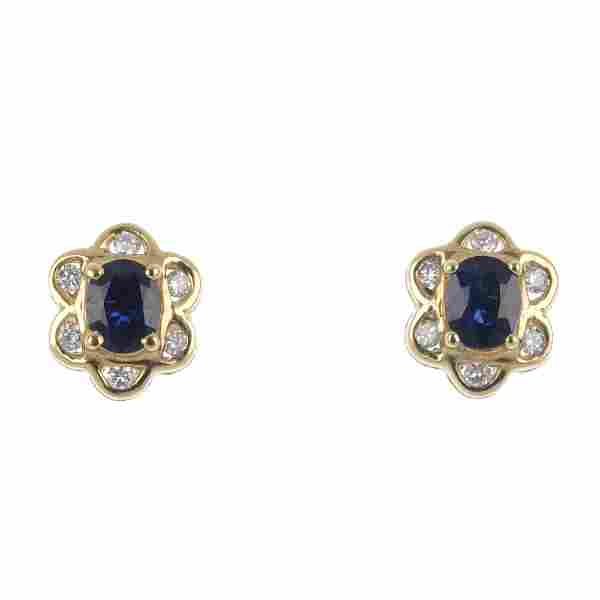 A pair of 18ct gold sapphire and diamond floral cluster