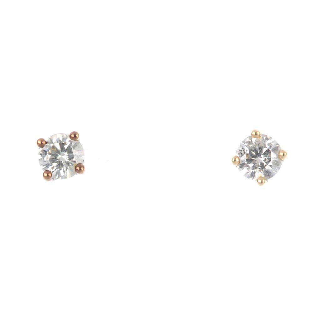 Two items of diamond jewellery.