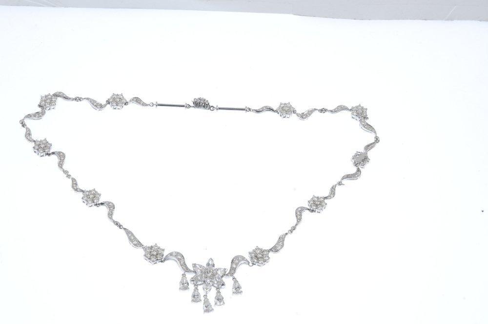 A diamond necklace. - 2