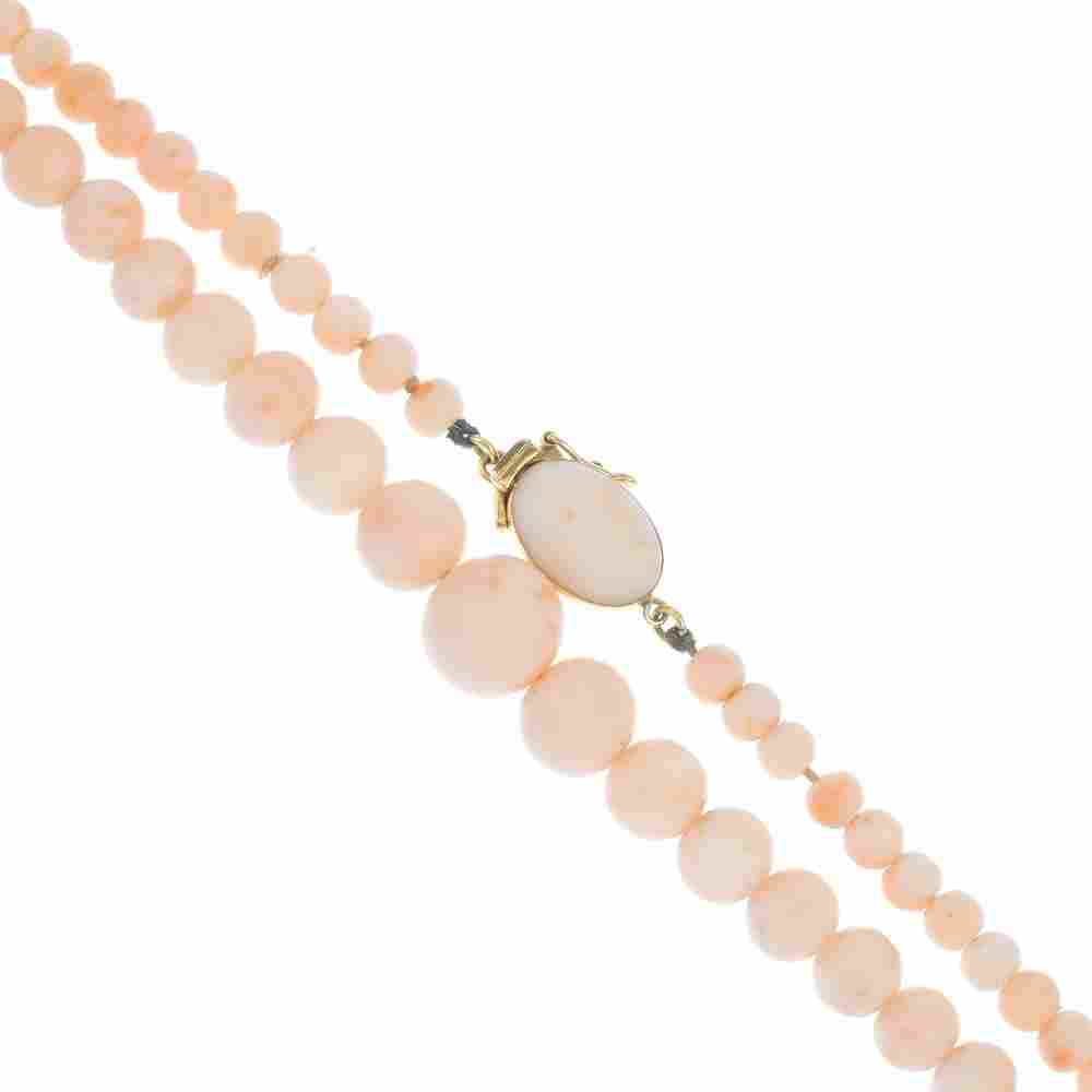A coral bead necklace.