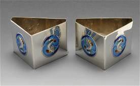 An Edwardian pair of silver  enamel napkin rings