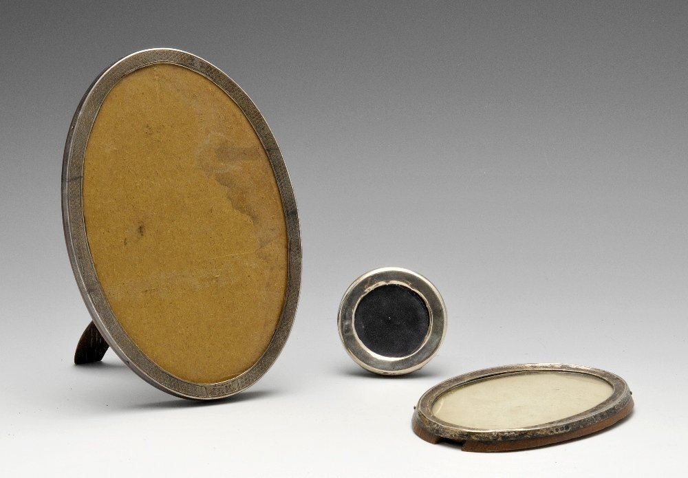 Two silver mounted oval frames & a small circular