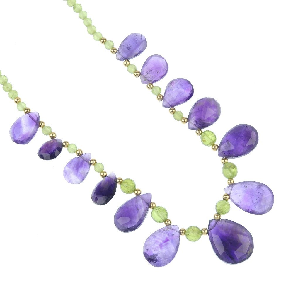 An amethyst and peridot necklace, bracelet and ear