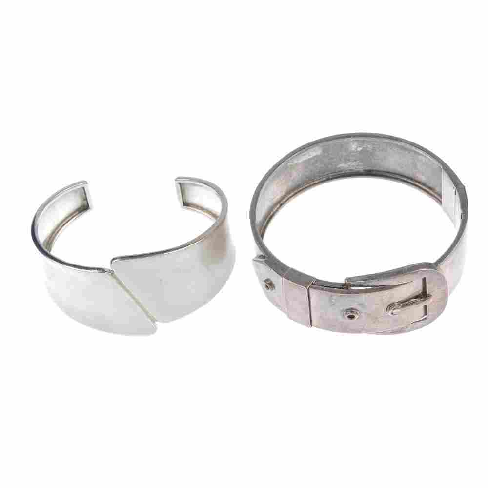 A selection of seven silver and white metal bangles.