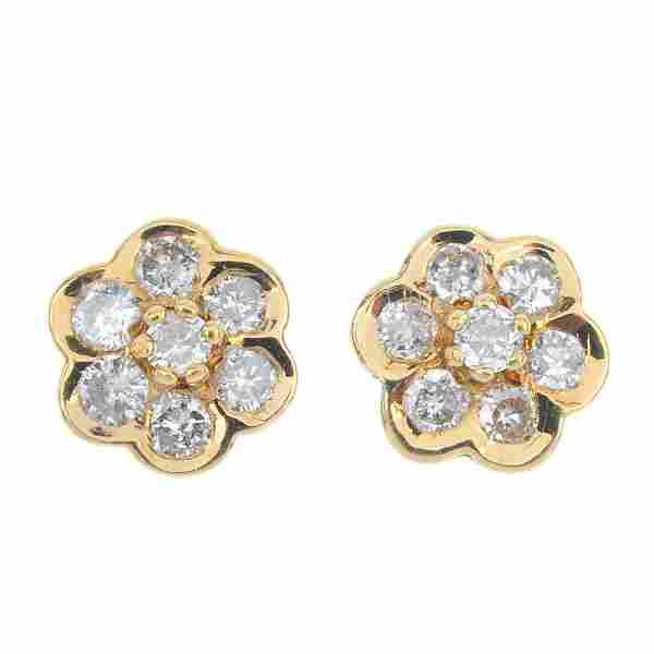 A pair of 18ct gold diamond floral cluster earrings.