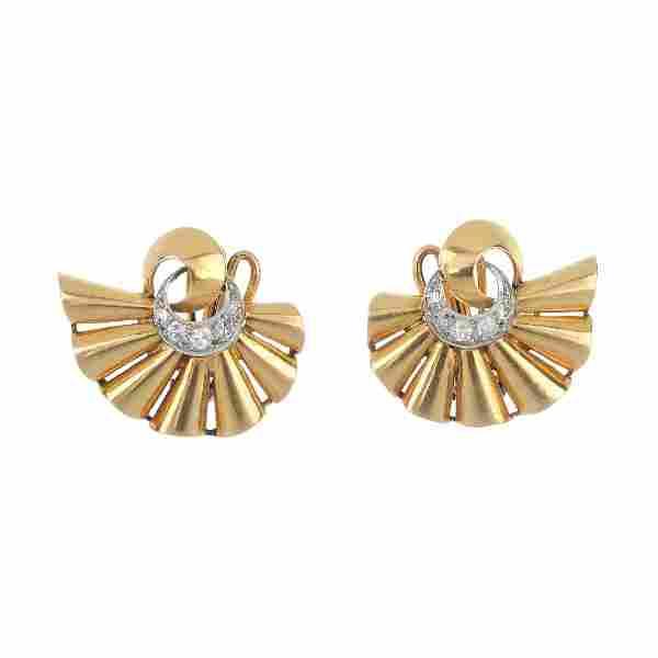 A pair diamond ear clips.