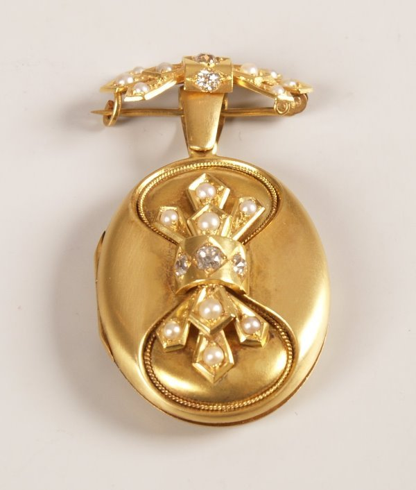 5: Seed pearl and diamond oval photo locket with a fitt
