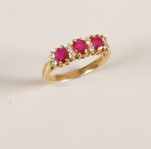12: 18ct gold ruby and diamond set half hoop ring, with