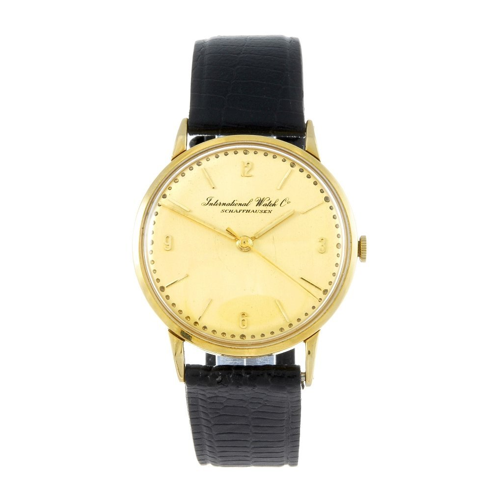 IWC - a gentleman's yellow metal wrist watch.