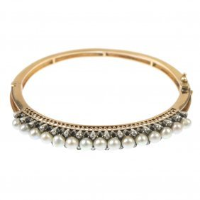 A Cultured Pearl And Diamond Hinged Bangle.