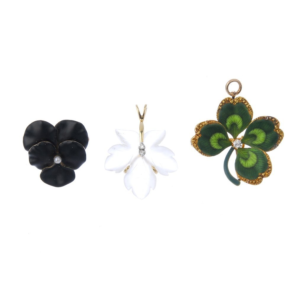 A selection of early 20th century gold floral pendants.
