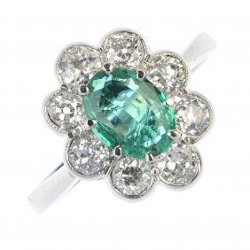 An Emerald And Diamond Floral Cluster Ring.