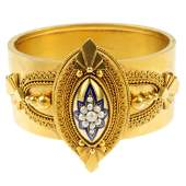 A mid Victorian gold enamel and split pearl bangle