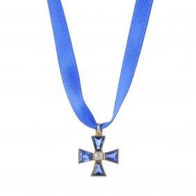 A Diamond And Sapphire Cross Pendant.