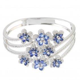 A Sapphire And Diamond Hinged Bangle.